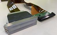 避免万能平板打印机uv灯反射造成喷头斜喷堵头的方法